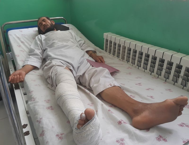 Wounded worker from a de-mining organisation receives treatment at a hospital in Baghlan province