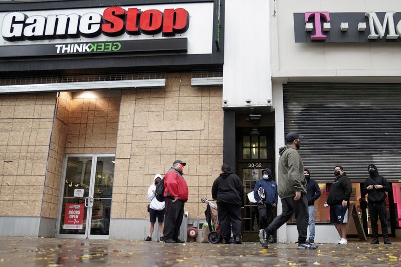FILE PHOTO: Outside a GameStop store people line up to purchase a Sony PS5 gaming console