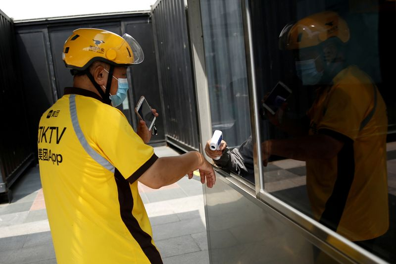 FILE PHOTO: Meituan delivery worker in Beijing amid COVID-19