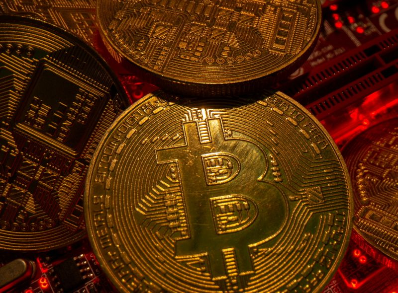 FILE PHOTO: Representations of the virtual currency Bitcoin stand on a motherboard in this picture illustration