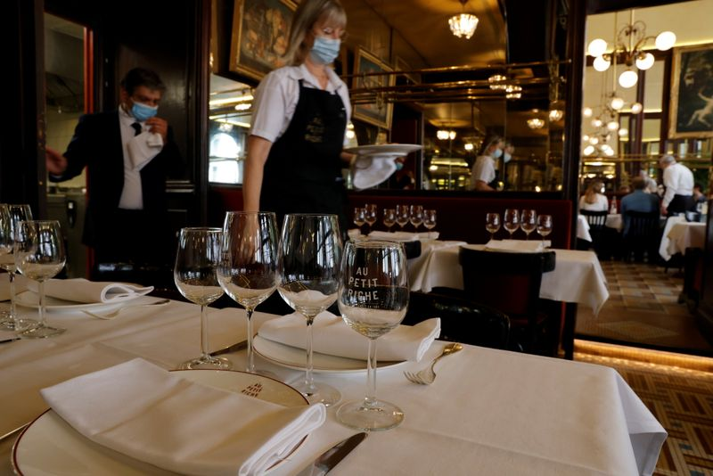 Restaurants reopen indoor dining rooms with an easing of COVID-19 restrictions in France