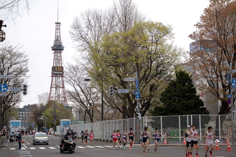 FILE PHOTO: Athletes compete at the half-marathon race which doubles as a test event for the 2020 Tokyo Olympics, in Sapporo, Japan