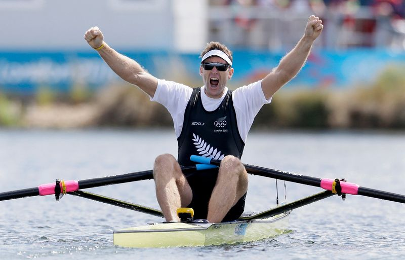 Mahe Drysdale of New Zealand celebrates winning gold in the men's rowing Single Sculls final during the London 2012 Olympic Games at Eton Dorney
