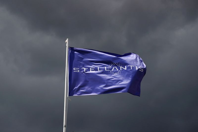 FILE PHOTO: A flag with the logo of Stellantis is seen near Paris