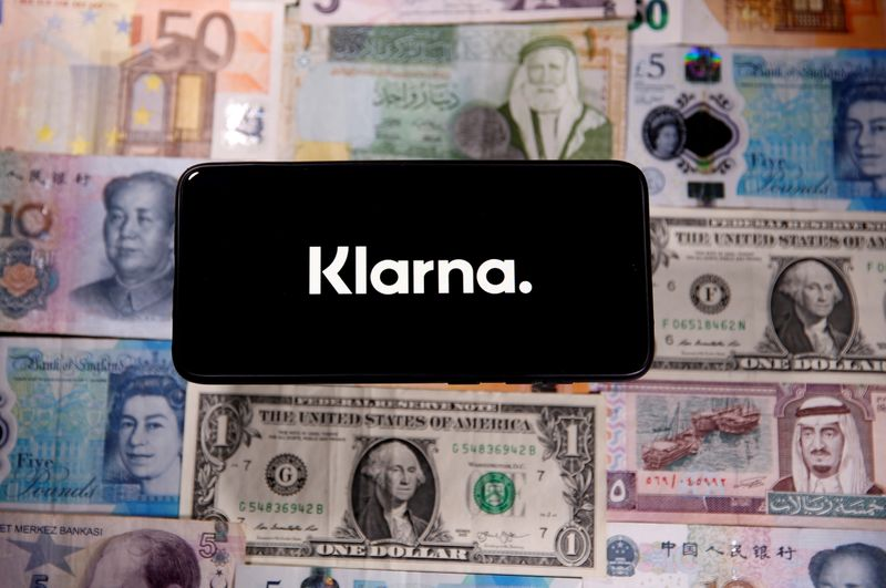 FILE PHOTO: A smartphone displays a Klarna logo on top of banknotes is in this illustration