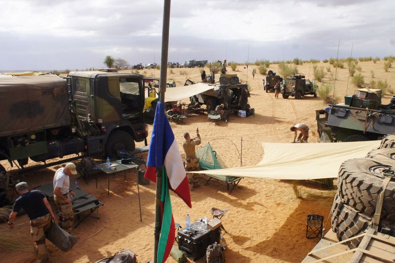 FILE PHOTO: French soldiers set up camp while waiting for the delivery of a replacement piece for a vehicle in Inat
