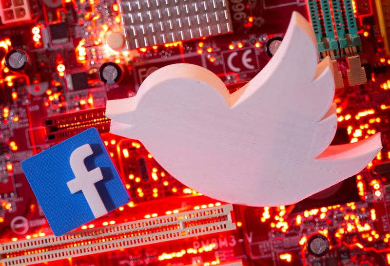 FILE PHOTO: Illustration of 3D printed Facebook and Twitter logos on a computer motherboard
