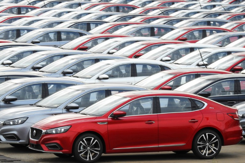 Cars for export wait to be loaded onto cargo vessels at a port in Lianyungang