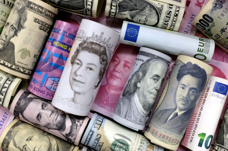 FILE PHOTO: FILE PHOTO: Euro, Hong Kong dollar, U.S. dollar, Japanese yen, pound and Chinese 100 yuan banknotes are seen in this picture illustration