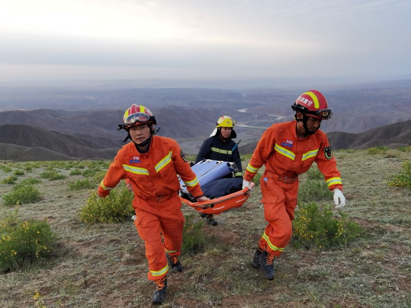 FILE PHOTO: Rescue workers work at the site of the accident where extreme cold weather killed participants of an 100-km ultramarathon race in Baiyin