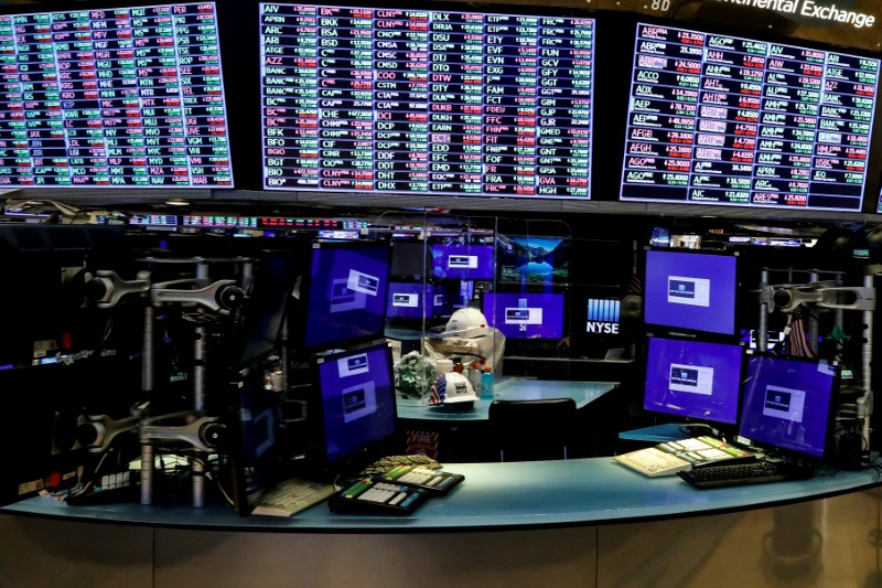 FILE PHOTO: Dividers are seen inside a trading post on the trading floor as preparations are made for the return to trading at the NYSE in New York