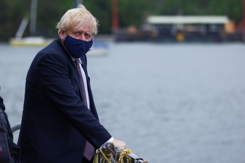 Britain's PM Johnson visits the workshop of Scott Woyka, in Falmouth