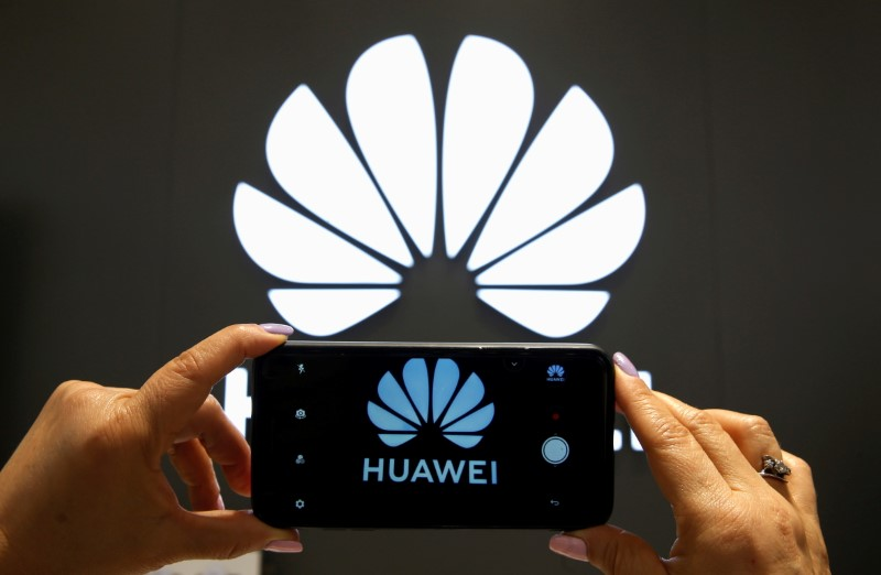 FILE PHOTO: A Huawei logo is seen on a cell phone screen in their store at Vina del Mar