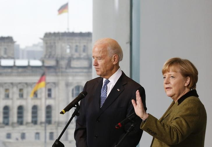 FILE PHOTO: German Chancellor Merkel and U.S. Vice President Biden leave after statement in Berlin