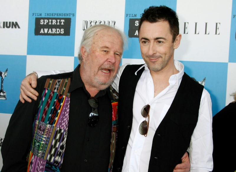 FILE PHOTO: Actors Ned Beatty and Alan Cumming arrive at Film Independent's Spirit Awards in Santa Monica