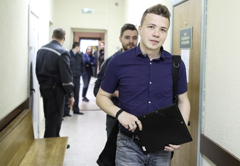 FILE PHOTO: Opposition blogger and activist Roman Protasevich arrives for a court hearing in Minsk
