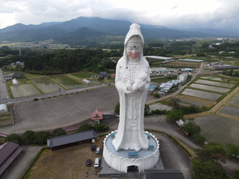 Drone picture shows a mask placed on a 57-metre-high statue of Buddhist goddess Kannon to pray for the end of the coronavirus disease (COVID-19) pandemic at Houkokuji Aizu Betsuin temple in Aizuwakamatsu, Fukushima Prefecture, Japan
