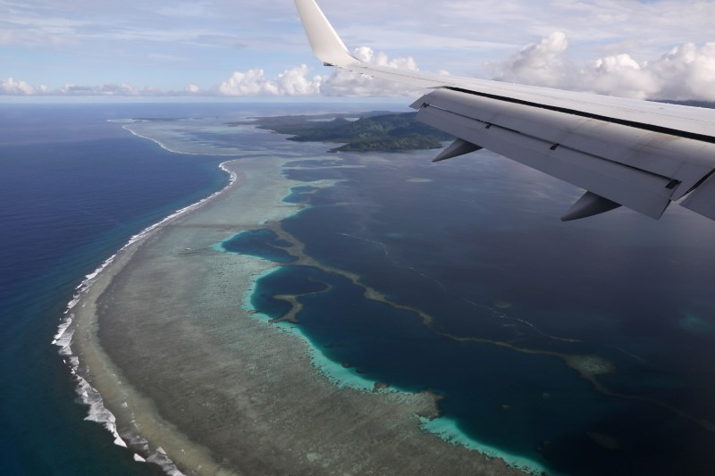 FILE PHOTO:  Plane carrying top U.S. diplomat  makes its landing approach on Pohnpei International Airport in Kolonia, Federated States of Micronesia