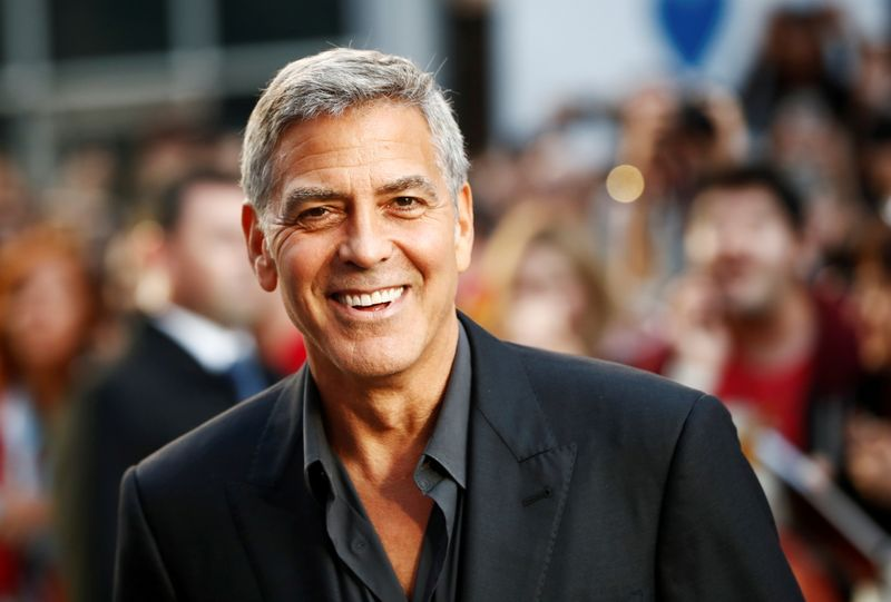 FILE PHOTO: Clooney arrives on the red carpet for the film
