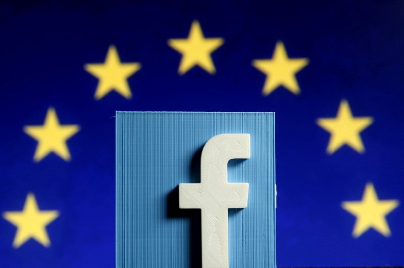 FILE PHOTO: Facebook logo in front of the EU flag