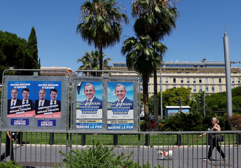 Electoral panels ahead of the second round of the French regionalelections in Nice