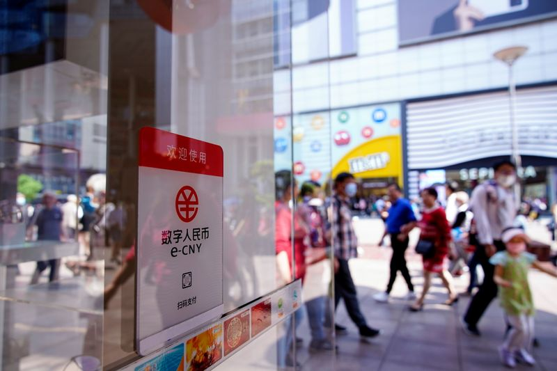 A sign indicating digital yuan, also referred to as e-CNY, is pictured at a shopping mall in Shanghai