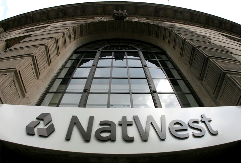 FILE PHOTO: Signage on a branch of NatWest Bank in central London