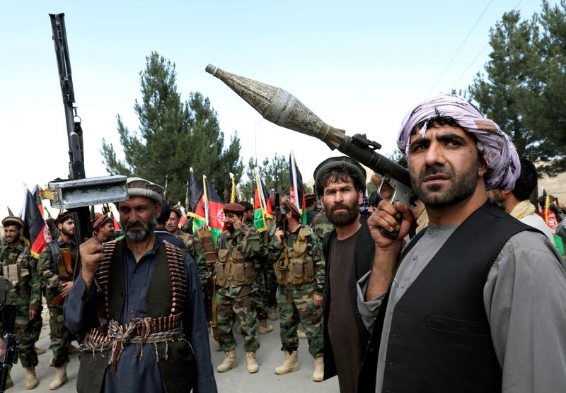 FILE PHOTO: Hundreds of armed men gather to announce their support for Afghan security forces on the outskirts of Kabul
