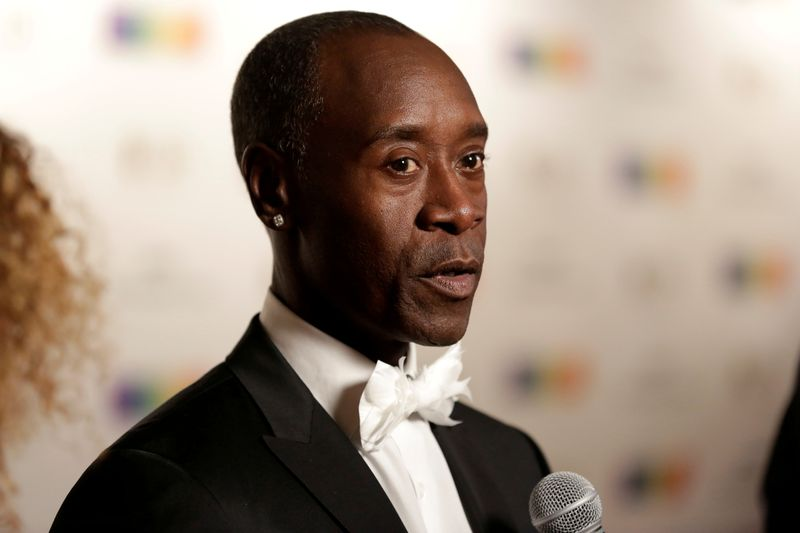FILE PHOTO: Actor Don Cheadle speaks to the media as he arrives for the Kennedy Center Honors in Washington