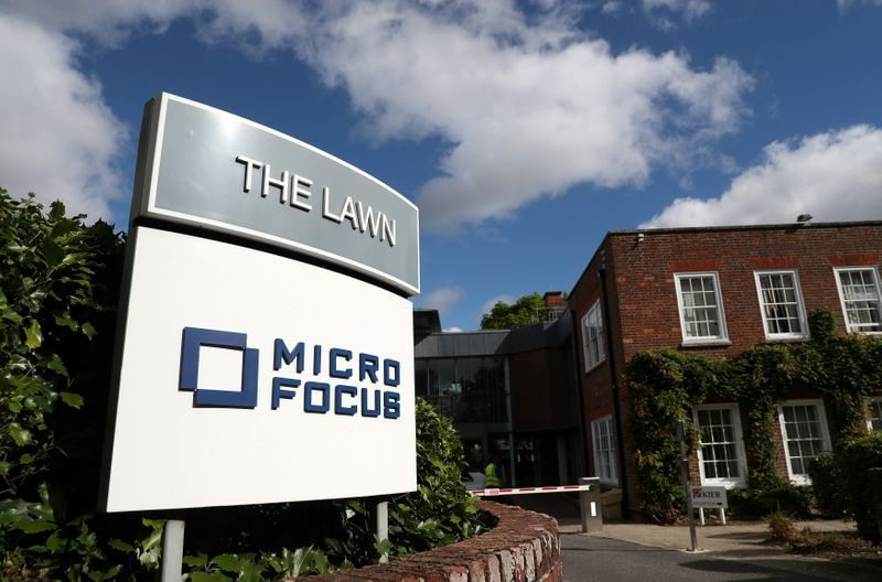 FILE PHOTO: Signs stand outside the offices of Micro Focus in Newbury