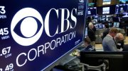 FILE – In this July 30, 2018, photo the logo for CBS Corporation is displayed above a trading post on the floor of the New York Stock Exchange. (AP Photo/Richard Drew, File)