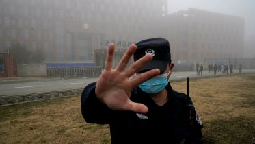 A security guard blocks journalists from the Wuhan Institute of Virology during a visit by World Health Organization investigators. (AP Photo)