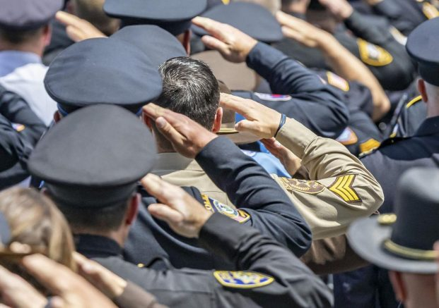 A large contingent of police officers from across the state and region were on hand to show their support for Officer Chris Oberheim in Decatur, Ill. (Clay Jackson/Herald & Review via AP)