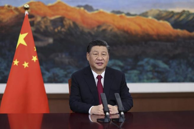 In this photo released by Xinhua News Agency, Chinese President Xi Jinping delivers a keynote speech. (Ju Peng/Xinhua via AP)