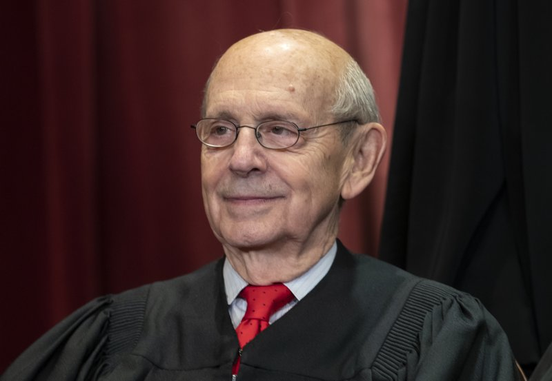 Justice Stephen Breyer sits with fellow Supreme Court justices for a group portrait at the Supreme Court Building in Washington. (AP Photo/J. Scott Applewhite, File)
