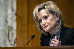 Sen. Cindy Hyde-Smith, R-Miss., questions Charles Rettig, commissioner of the Internal Revenue Service (IRS), during a hearing on Capitol Hill in Washington, Wednesday, May 19, 2021. (Samuel Corum/Pool via AP)