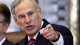 ILE - In this Feb. 5, 2019, file photo, Texas Gov. Greg Abbott gives his State of the State Address in the House Chamber in Austin, Texas. Texas lawmakers have given final approval to allowing people carry handguns without a license, and the background check and training that go with it. The Republican-dominated Legislature approved the measure Monday, May 24, 2021 sending it to Gov. Abbott. (AP Photo/Eric Gay, File)