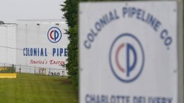 FILE - In this May 12, 2021, file photo, the entrance of Colonial Pipeline Company in Charlotte, N.C. U.S. pipeline operators will be required for the first time to conduct a cybersecurity assessment under a Biden administration directive to be issued Thursday in response to the ransomware hack that disrupted gas supplies in several states this month. (AP Photo/Chris Carlson, File)