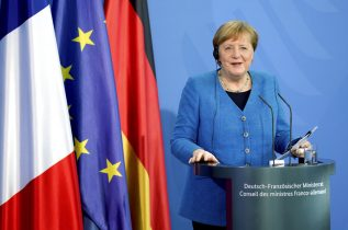 German Chancellor Angela Merkel smiles during a joint press conference with French President Emmanuel Macron as part of a virtual Plenary Session of the Franco-German Council of Ministers in Berlin, Germany, Monday, May 31, 2021. (AP Photo/Michael Sohn, pool)