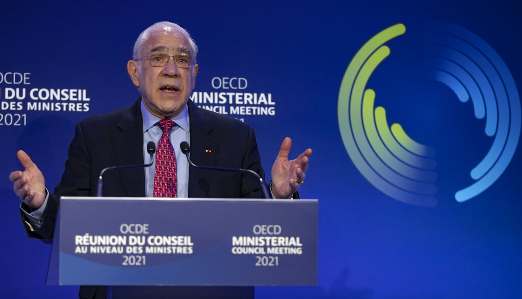Outgoing Secretary General of the Organisation for Economic Cooperation and Development (OECD) Angel Gurria delivers his speech during the handover ceremony at the OECD headquarters in Paris. (Ian Langsdon, Pool via AP)