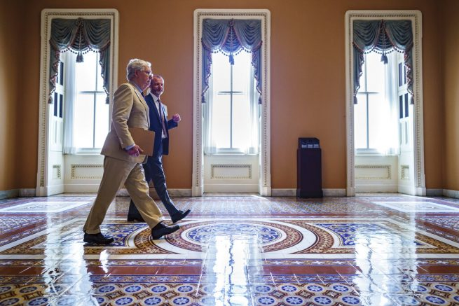 Senate Minority Leader Mitch McConnell, R-Ky., accompanied by Robert Duncan, the secretary for the minority, walks to the chamber as the Senate resumes work following a ten-day recess, at the Capitol in Washington. (AP Photo/J. Scott Applewhite)