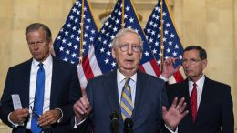 Senate Minority Leader Mitch McConnell of Ky., center, accompanied by Senate Minority Whip Sen. John Thune of South Dakota, left, and Sen. John Barrasso, R-Wyo., speaks with reporters after a Republican caucus luncheon on Capitol Hill, Tuesday, June 8, 2021, in Washington. (AP Photo/Alex Brandon)