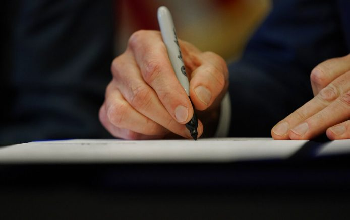 Texas Gov. Greg Abbott signs one of two energy related bills, Tuesday, June 8, 2021, in Austin, Texas. Abbot signed legislation into law to reform the Electric Reliability Council of Texas (ERCOT) and weatherize and improve the reliability of the state's power grid. (AP Photo/Eric Gay)