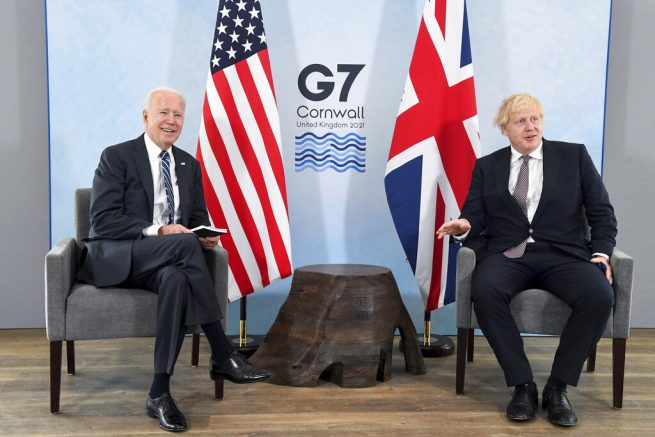Joe Biden, left, poses for a photo with Britain's Prime Minister Boris Johnson, right, during their meeting ahead of the G7 summit in Cornwall, Britain. (Toby Melville/Pool Photo via AP)