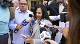 """Mariel Colon, an attorney for the wife of Mexican drug kingpin Joaquin """"El Chapo"""", Emma Coronel Aispuro, walks past reporters outside federal court Washington, Thursday, June 10, 2021. (AP Photo/Susan Walsh)"""