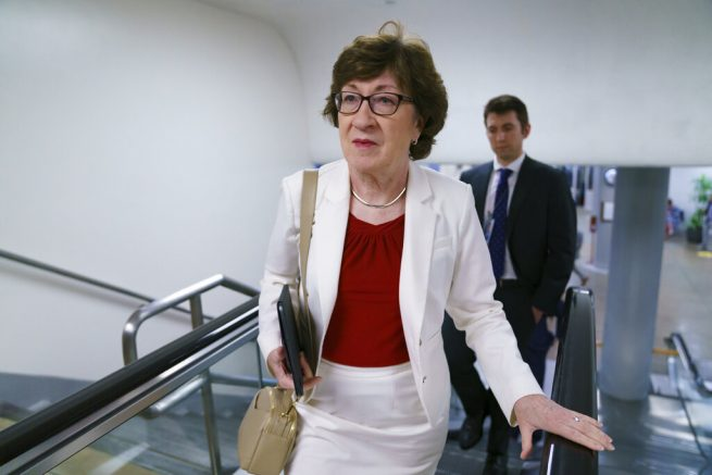 Sen. Susan Collins, R-Maine, walks to the Senate chamber for votes, at the Capitol in Washington, Thursday, June 10, 2021. Sen. Collins is working with a bipartisan group of 10 senators negotiating an infrastructure deal with President Joe Biden. (AP Photo/J. Scott Applewhite)