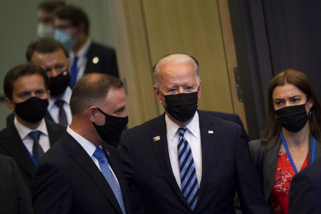 U.S. President Joe Biden, center, arrives for a plenary session during a NATO summit at NATO headquarters in Brussels, Monday, June 14, 2021. U.S. President Joe Biden is taking part in his first NATO summit, where the 30-nation alliance hopes to reaffirm its unity and discuss increasingly tense relations with China and Russia, as the organization pulls its troops out after 18 years in Afghanistan. (Brendan Smialowski, Pool via AP)