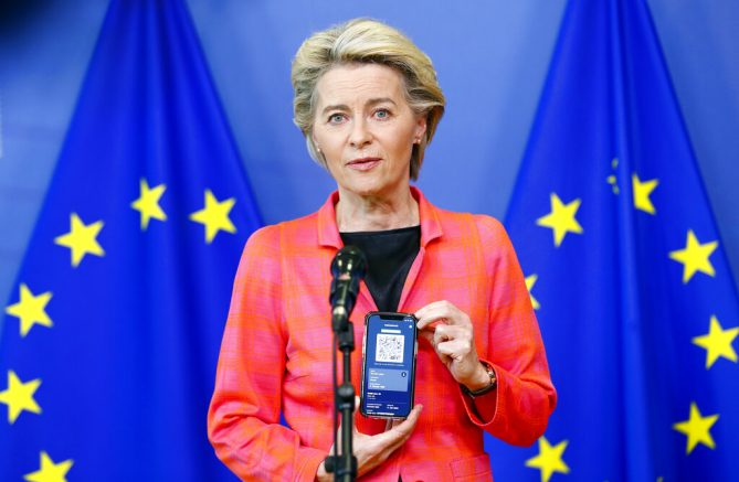 European Commission President Ursula von der Leyen shows a phone, as she gives a press statement on the new COVID-19 digital travel certificate at the European Commission headquarters in Brussels, Wednesday, June 16, 2021. (Johanna Geron/Pool Photo via AP)