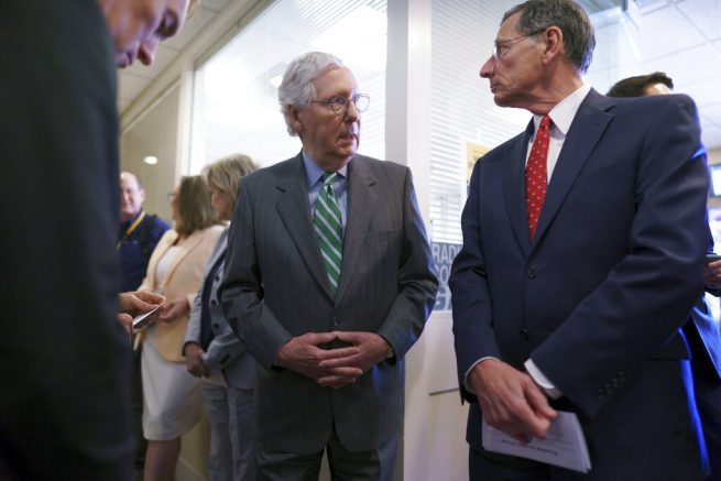 Senate Minority Leader Mitch McConnell, R-Ky., center, waits with Sen. John Barrasso, R-Wyo., chairman of the Senate Republican Conference, and other Republican senators before a news conference to criticize the Democrat push to pass a voting rights bill, at the Capitol in Washington, Thursday, June 17, 2021. (AP Photo/J. Scott Applewhite)