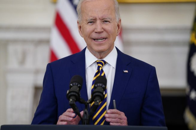 Joe Biden speaks about reaching 300 million COVID-19 vaccination shots, in the State Dining Room of the White House, Friday, June 18, 2021, in Washington. (AP Photo/Evan Vucci)